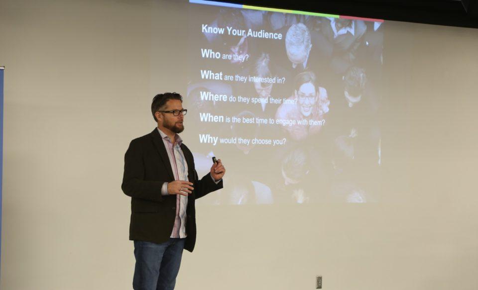 Chris Hanson speaking at Breakfast at Google